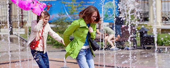 Teens playing in fountain