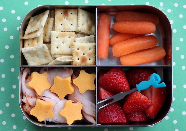 School Lunchbox with cheese, meat, frut and crackers