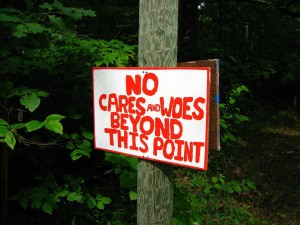 No Cares and Woes Beyond This Point Sign on Tree