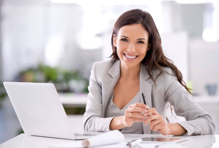Professional Woman Sitting at Desk with