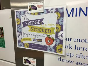 """The Fridge Has Been Stocked"" Sign on Fridge"