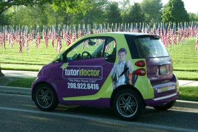 Tutor Doctor Smart Car in Front of USAF Flags